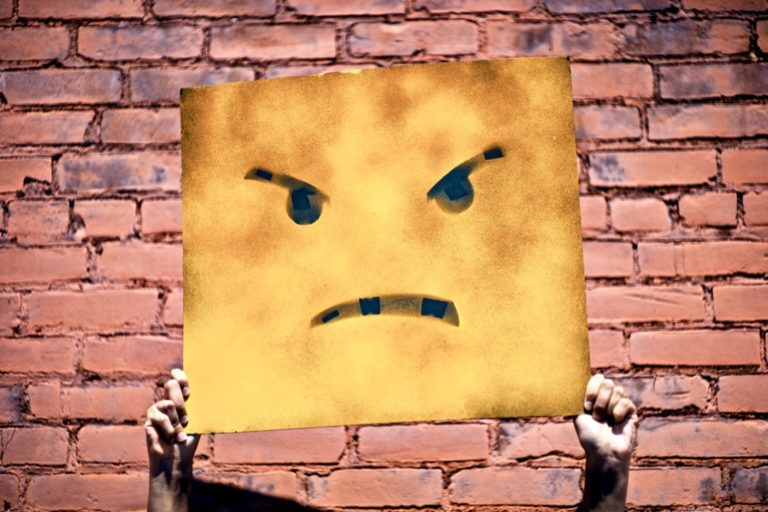 Enttäuschung verarbeiten beschrieben durch ein traurigen Smiley
